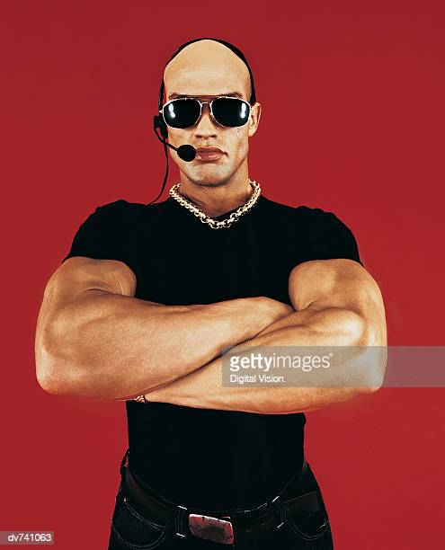 Bouncer Wearing Sunglasses with Arms Crossed