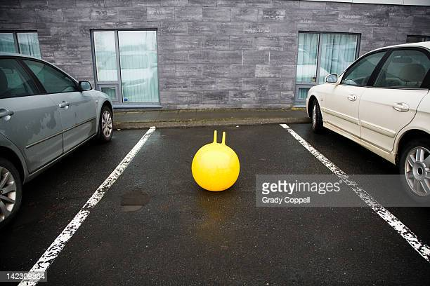 Bouncy toy in car parking space