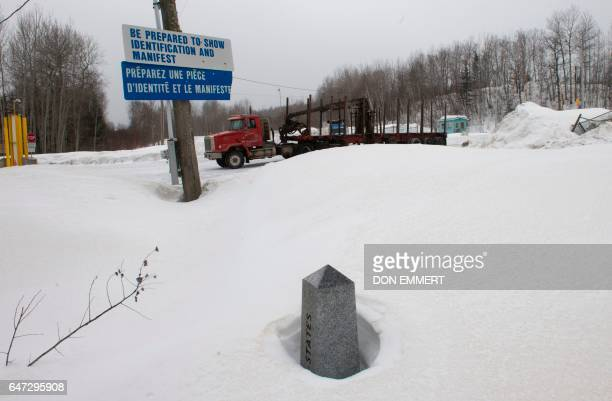 A boundary marker marks the US/Canada border March 2 in Estcourt Maine On the one side of the marker is Estcourt and one the other side is...