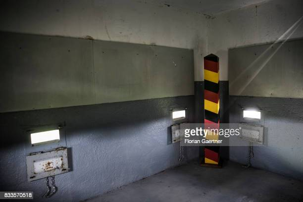 A boundary post in the colors of the german flag is place in a watchtower near the former innerGerman border on August 15 2017 in Hoyersburg Germany