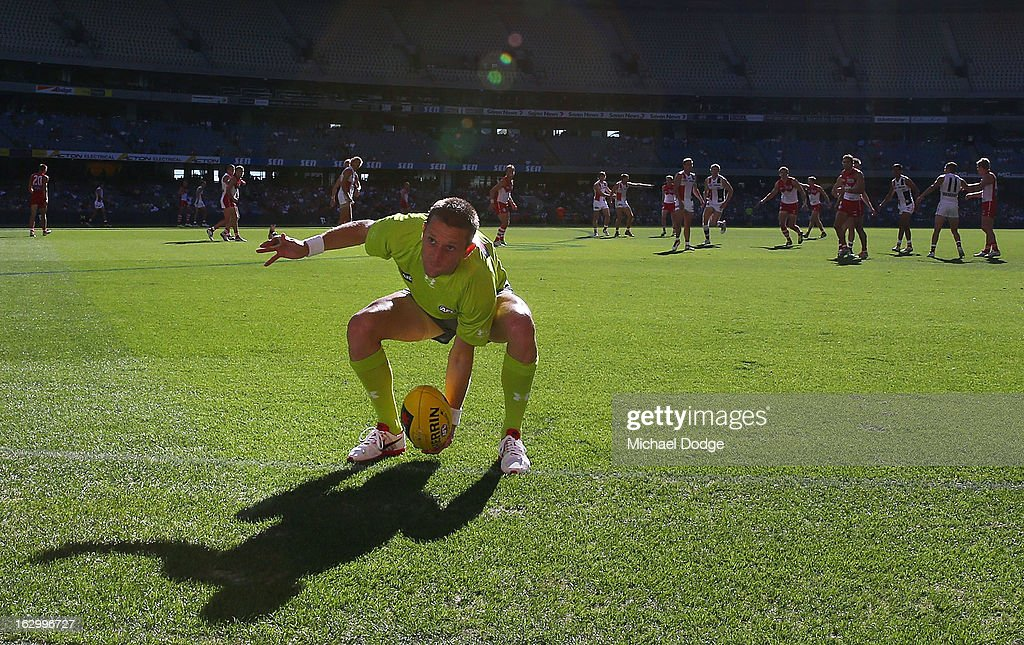 A boundary umpire throws the ball back into play during the round two AFL NAB Cup match between the St Kilda Saints and the Sydney Swans at Etihad Stadium on March 3, 2013 in Melbourne, Australia.