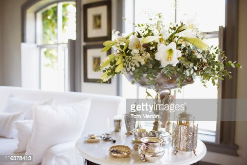 Bouquet and silver on living room table : Stock Photo