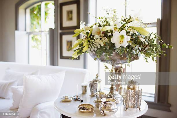 Bouquet and silver on living room table