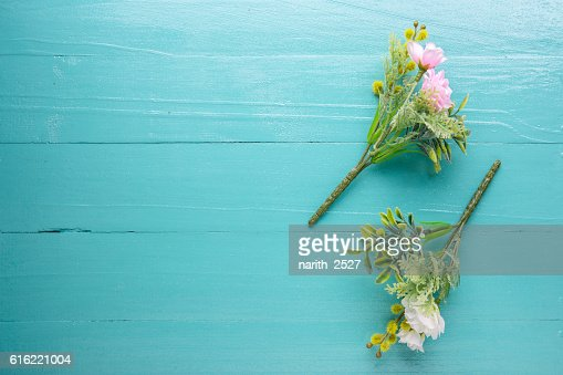 Bouquet of beautiful fresh flower artificial on wood background : Stock Photo