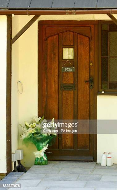 A bouquet of flowers is left on the door step of Wishing Well Farm at Brokerswood near Westbury Wiltshire the home of Neil Puttick his Japanese wife...