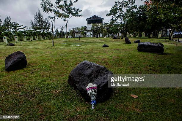 A bouquet of flowers is seen to commemorate the ten anniversary of tsunami at mass grave on December 25 2014 in Banda Aceh Indonesia Aceh was the...