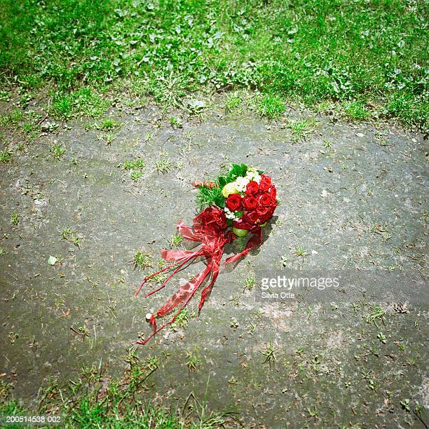 bouquet of flowers on ground, high angle view