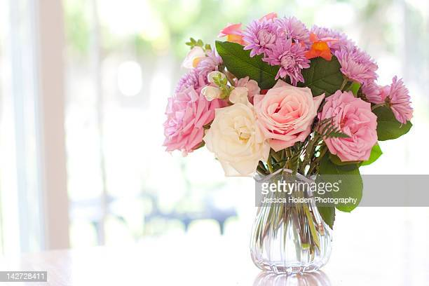Bouquet of flowers on table near window