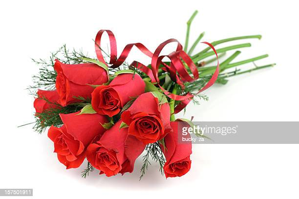 Bouquet of long stemmed red roses isolated on white