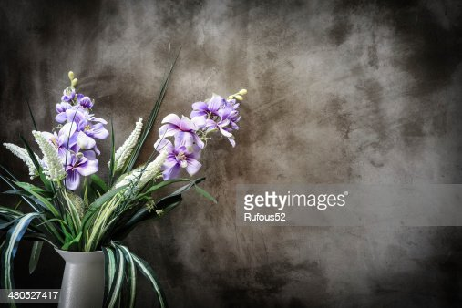 Bouquet of peonies in a vase against  wall. Interior : Stock Photo