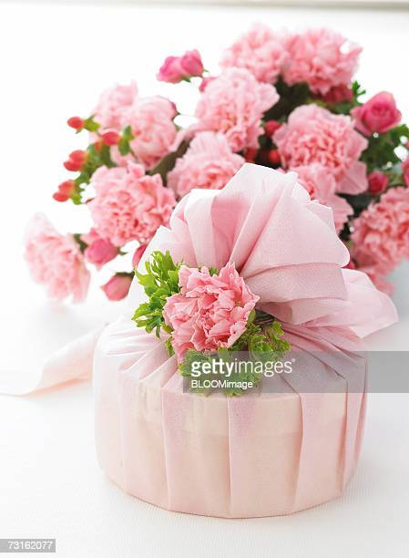 Bouquet of pink flowers and gift box