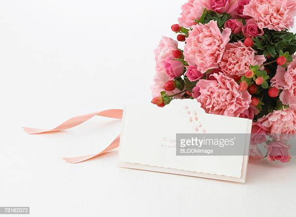 Bouquet of pink flowers and message card