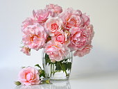 Bouquet of pink roses in a vase. Romantic floral decoration with garden roses.