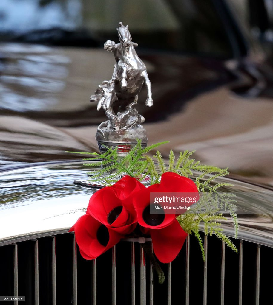 A bouquet of poppies adorn the bonnet of Queen Elizabeth II's Bentley car as she arrives to reopen the Sir Joseph Hotung Gallery at the British Museum on November 8, 2017 in London, England.