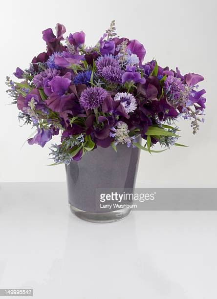 A bouquet of purple flowers in a vase
