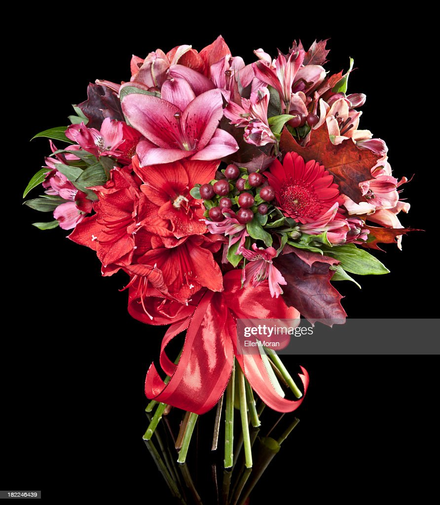 Bouquet of red and purple flowers on a black background