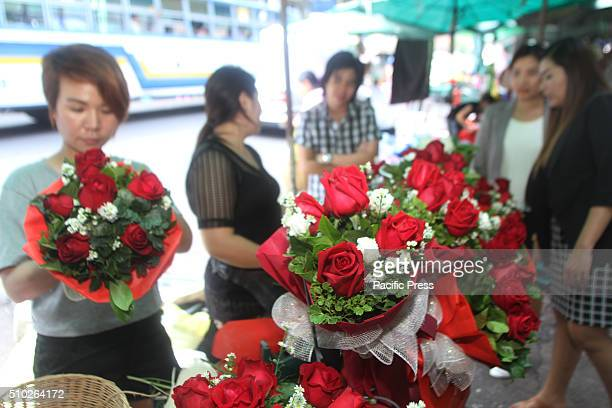 A bouquet of red roses prepared by vendor for sale before the Valentines Day celebration