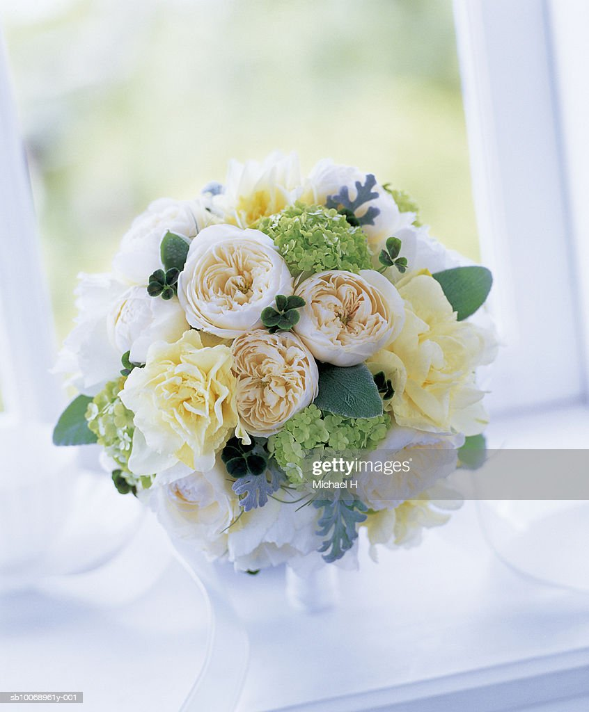 Bouquet of rose, cloverleaf, dusty miller, stachys byzantina and spanish moss : Stock Photo