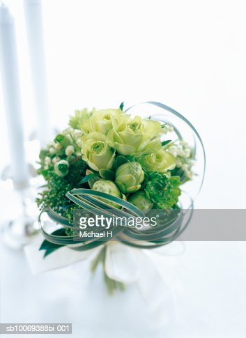 Bouquet of rose, hellebors, lily of the valley, ranunculus, gerbera and miscanthus : Stock Photo