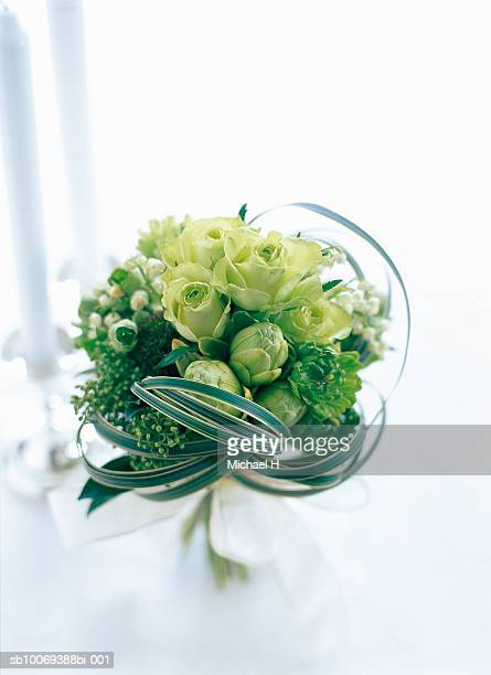 Bouquet of rose, hellebors, lily of the valley, ranunculus, gerbera and miscanthus