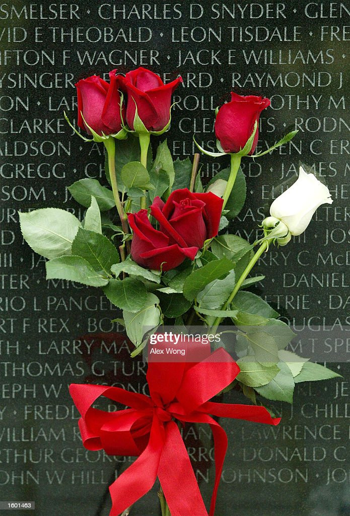A bouquet of roses is shown at the Vietnam Veterans Memorial November 10, 2002 in Washington, DC. This year's Veterans Day marks the 20th anniversary of the Vietnam Veterans Memorial.