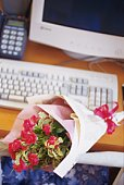 Bouquet of roses on desk, high angle view, differential focus