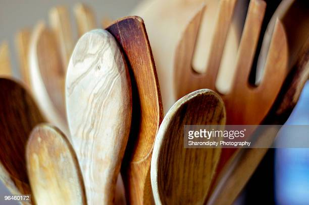 Bouquet of wooden spoons in kitchen