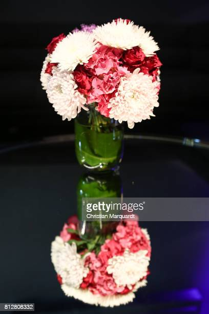 A bouquet reflected on a glass plate during the 'Kians Garden Flower Shop' Opening Event at Kantstrasse on July 11 2017 in Berlin Germany
