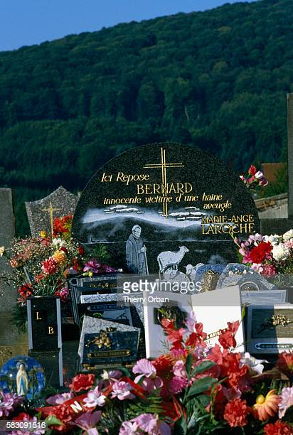 Bouquets decorate the grave of Bernard Laroche in Jussarupt Cemetery Laroche was murdered by JeanMarie Villemin in 1985 | Location Jussarupt France