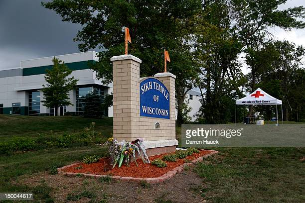Bouquets of flowers are left at the entrance to the Sikh Temple of Wisconsin August 9 2012 in Oak Creek Wisconsin Suspected gunman 40yearold Wade...