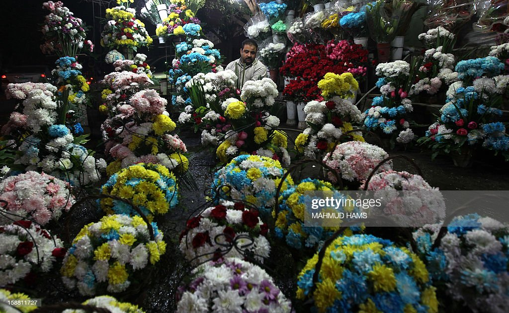 Bouquets of flowers are made ready for sale as people prepare to mark the dawn of a New Year in Cairo, on December 30, 2012. AFP PHOTO/MAHMUD HAMS