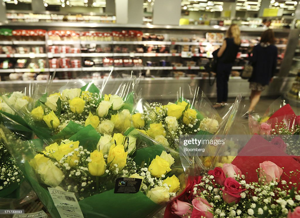 Bouquets of flowers are seen as customers browse chilled food cabinets inside a Marks & Spencer Group Plc (M&S) food hall in the Westfield Stratford City retail complex in London, U.K., on Thursday, June 27, 2013. U.K. retail sales rose more than economists forecast in May as consumers spent more online and food sales increased at their fastest pace for more than two years. Photographer: Chris Ratcliffe/Bloomberg via Getty Images