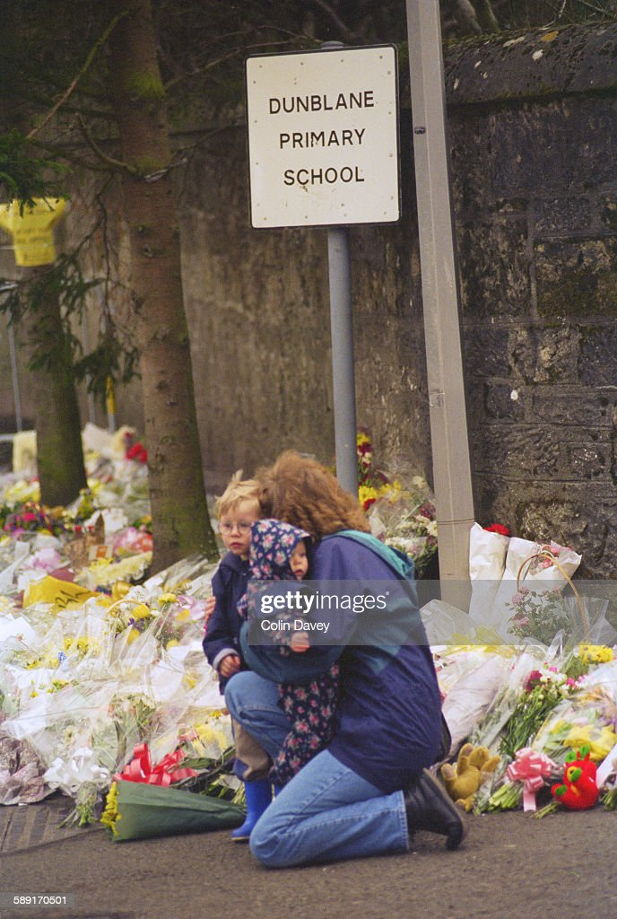 Bouquets outside Dunblane Primary School in Scotland, a few days after a gun massacre in which 17 people were killed, 17th March 1996.