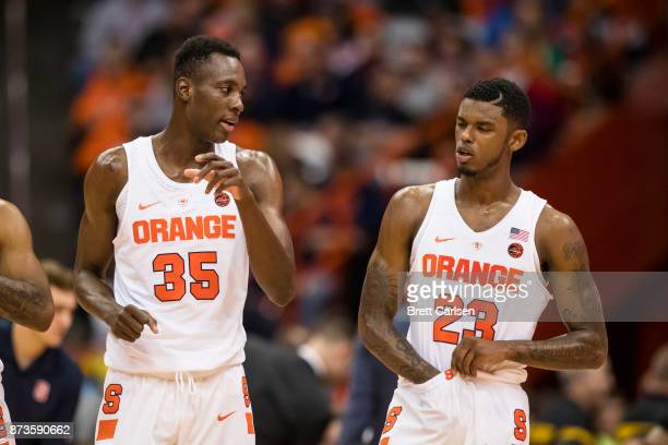 Bourama Sidibe and Frank Howard of the Syracuse Orange talk during the game against the Cornell Big Red at the Carrier Dome on November 10 2017 in...