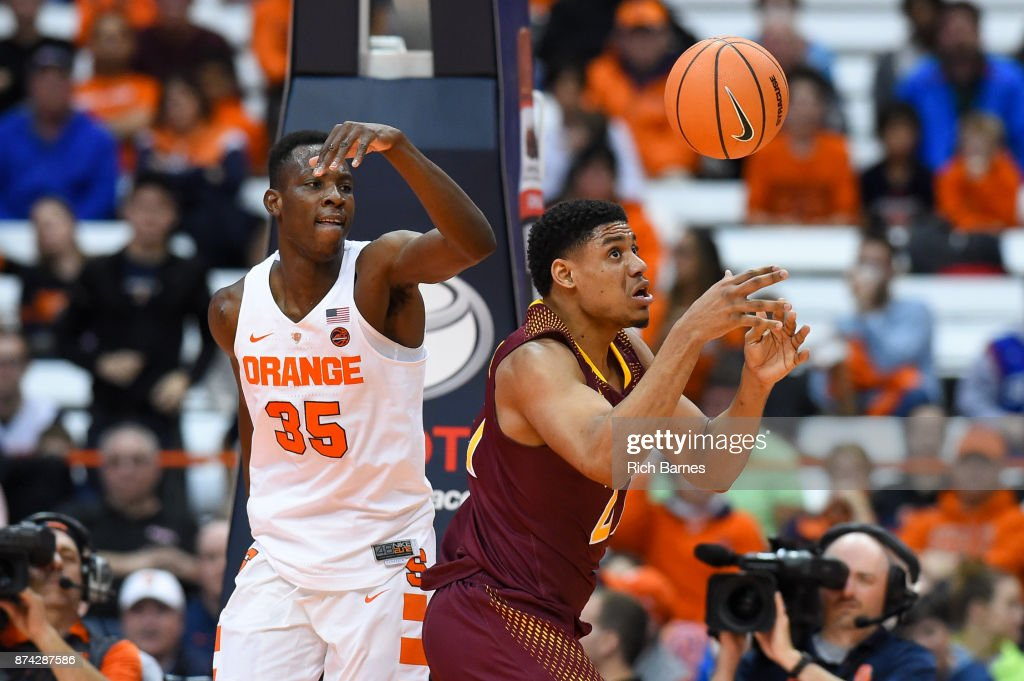 Bourama Sidibe #35 of the Syracuse Orange and Gavin Kensmil #21 of the Iona Gaels react to a loose ball during the second half at the Carrier Dome on November 14, 2017 in Syracuse, New York. Syracuse defeated Iona 71-62.