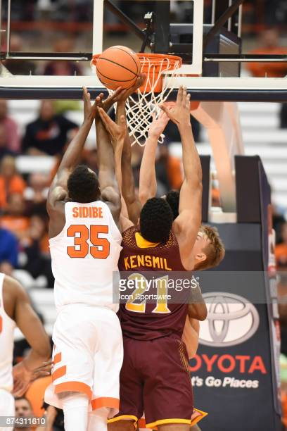 Bourama Sidibe of the Syracuse Orange and Gavin Kensmil of the Iona Gaels fight for a rebound during the second half of play between the Syracuse...
