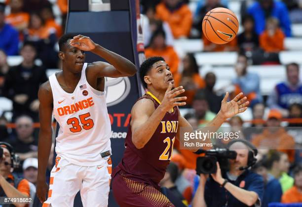 Bourama Sidibe of the Syracuse Orange and Gavin Kensmil of the Iona Gaels react to a loose ball during the second half at the Carrier Dome on...