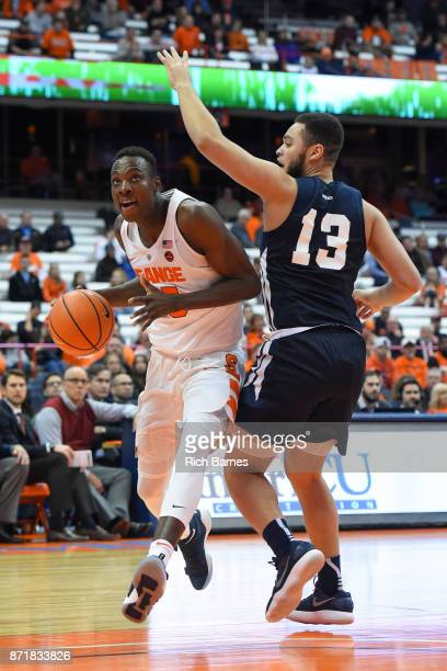 Bourama Sidibe of the Syracuse Orange drives to the basket past Taurus Adams II of the Southern Connecticut State Owls during the second half at the...