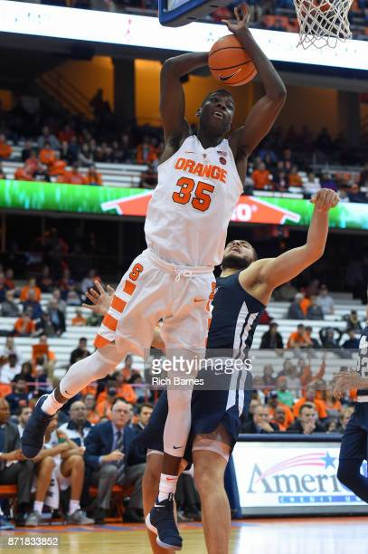 Bourama Sidibe of the Syracuse Orange loses control of the ball as Taurus Adams II of the Southern Connecticut State Owls defends during the second...