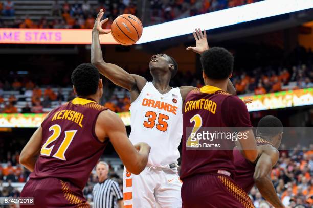 Bourama Sidibe of the Syracuse Orange loses control of the ball between Gavin Kensmil and EJ Crawford of the Iona Gaels during the first half at the...