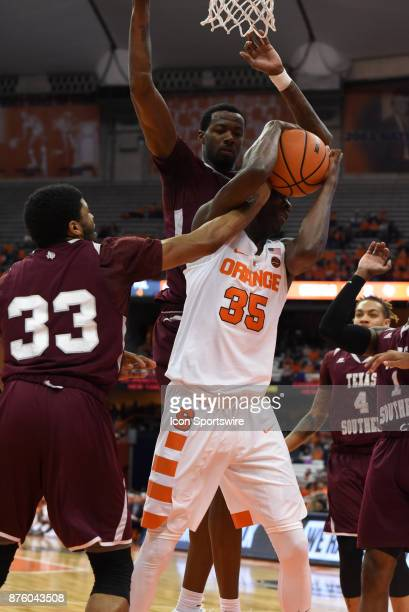 Bourama Sidibe of the Syracuse Orange pulls down a offensive rebound during the first half of play between the Syracuse Orange and the Texas Southern...