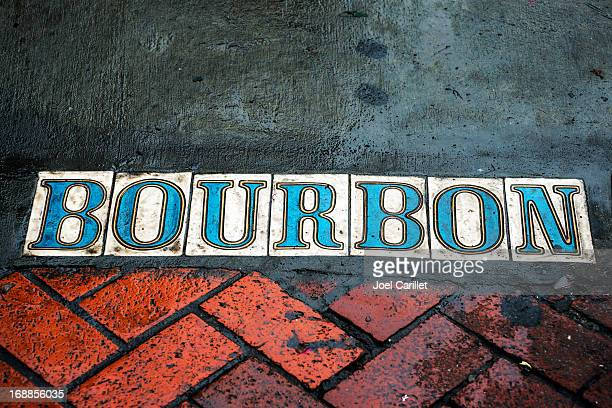 Bourbon street on sidewalk in French Quarter