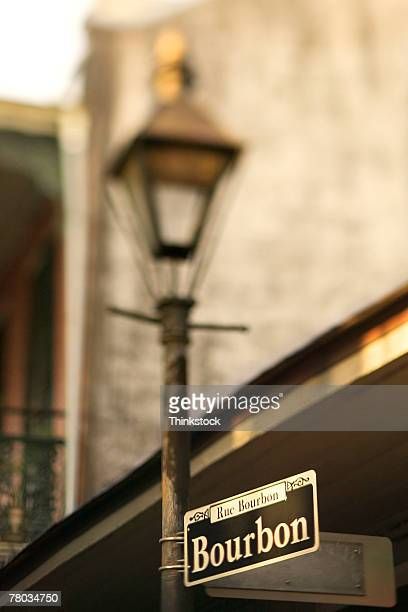 Bourbon Street sign on lamppost, French Quarter, New Orleans, Louisiana