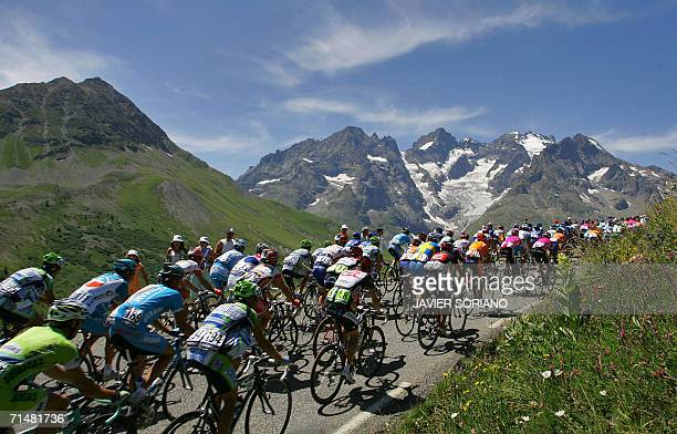 Bourgd'Oisans FRANCE The pack rides in the Alps during the 182 km sixteenth stage of the 93rd Tour de France cycling race from Bourg d'Oisans to La...