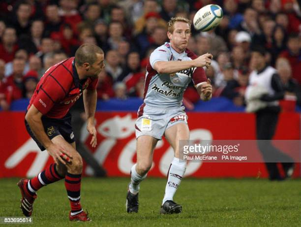Bourgoin's Mike Prendergast passes the ball away from Munster's Marcus Horan during the Heineken Cup match at Thomond Park Limerick