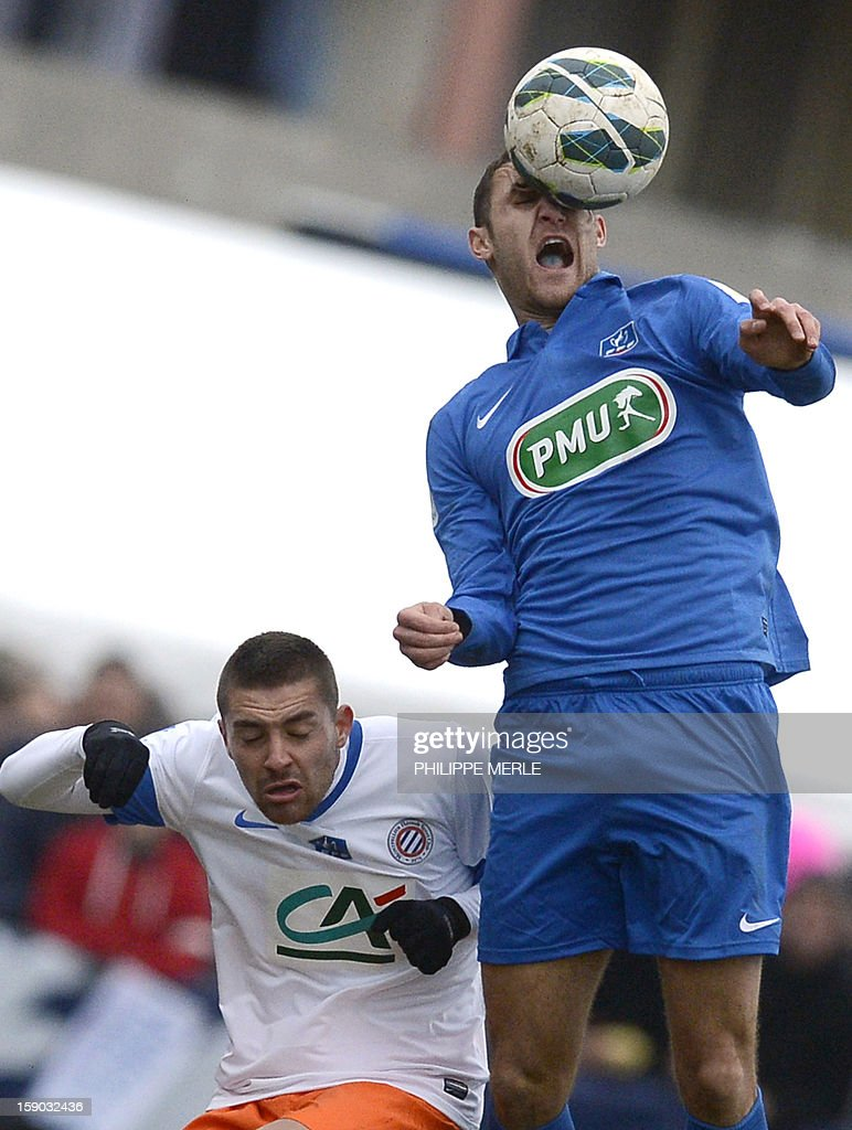 Bourg-Perronnas French midfielder Jimmy Nirlo (R) heads the ball during the French Cup football match Bourg-Peronnas vs Montpellier, on January 6, 2013 at the municipal stadium in Bourg-Peronnas. MERLE