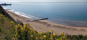 A sweeping panorama of Bournemouth Beach with the Pier to the left.