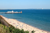 Bournmouth Beach and Pier with the Isle of Wight in the background. Bournemouth is one of the most popular seaside resorts in the UK.