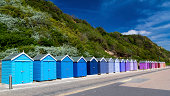 Colourful wooden beach huts at Bournemouth on the South Coast of England UK Europe