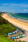 Sunshine illuminates golden beaches and blue-green seas along the Dorset coast at Middle Chine between Poole and Bournemouth
